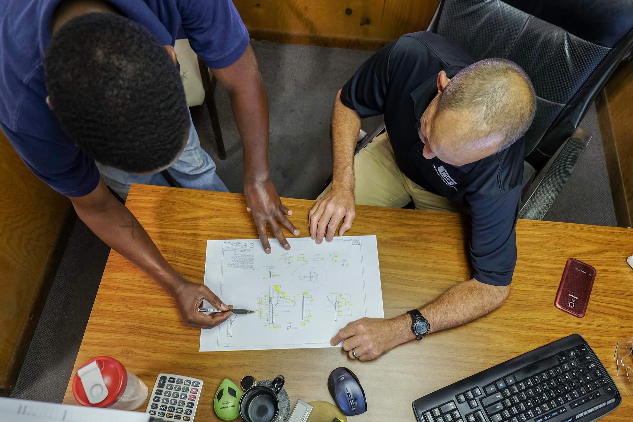 Engineering Team Reviewing Prints